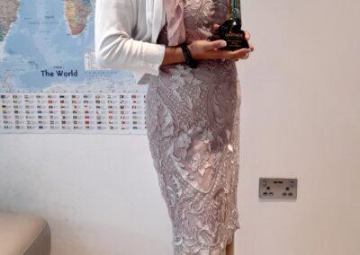 Ayesha Aslam holding Award