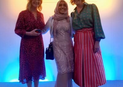 Ayesha Aslam with two ladies at women of the year